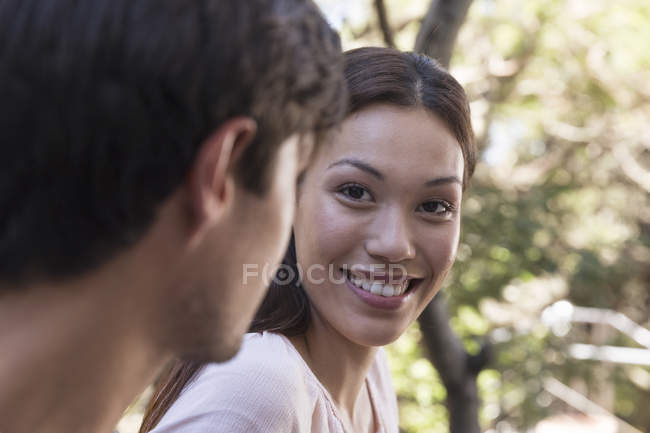Woman smiling at boyfriend — Stock Photo