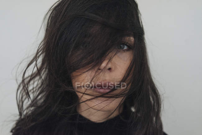 Woman with dishevelled hair — Stock Photo