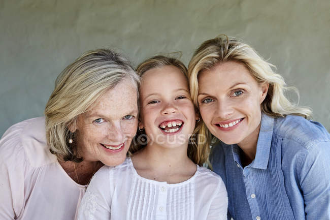 Girl with mother and grandmother head to head — Stock Photo