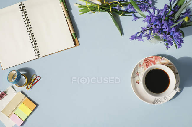 Notebook with office supplies and coffee — Stock Photo