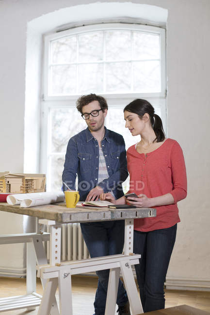 Man and woman discussing draft — Stock Photo