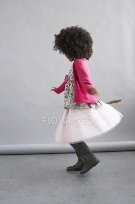 Girl dancing in white skirt — Stock Photo