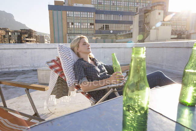 Woman relaxing on terrace — Stock Photo