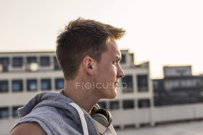 Portrait of young man with headphones looking aside — Stock Photo