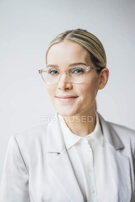 Blond businesswoman wearing glasses — Stock Photo