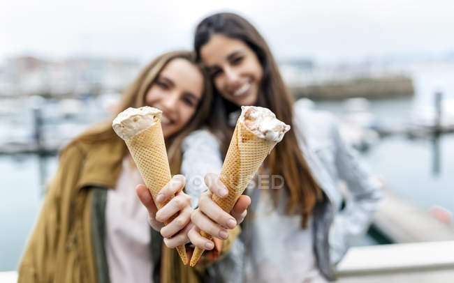 Young women showing icecreams — Stock Photo