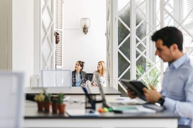 Business people talking on balcony — Stock Photo