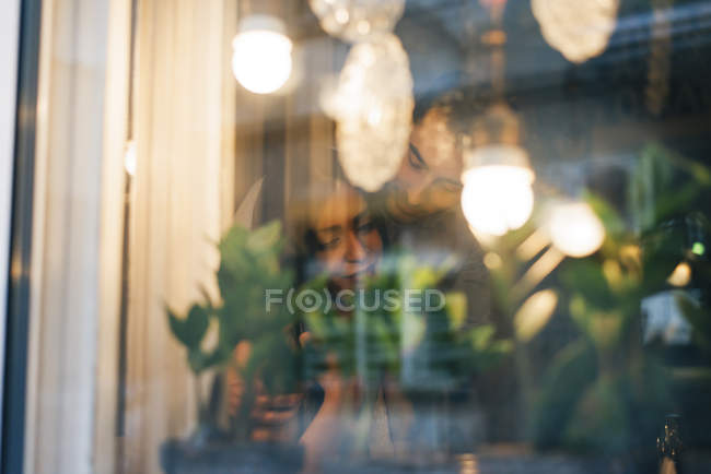 Couple hugging behind window pane — Stock Photo
