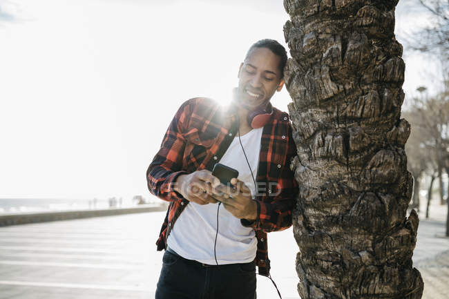 Smiling young man with headphones — Stock Photo