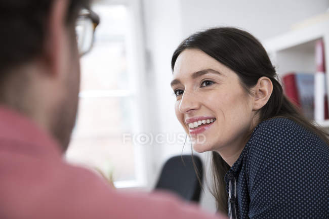 Smiling woman looking at man — Stock Photo