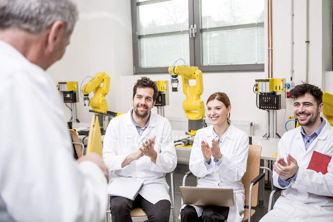 Engineers applauding for boss making a speech — Stock Photo