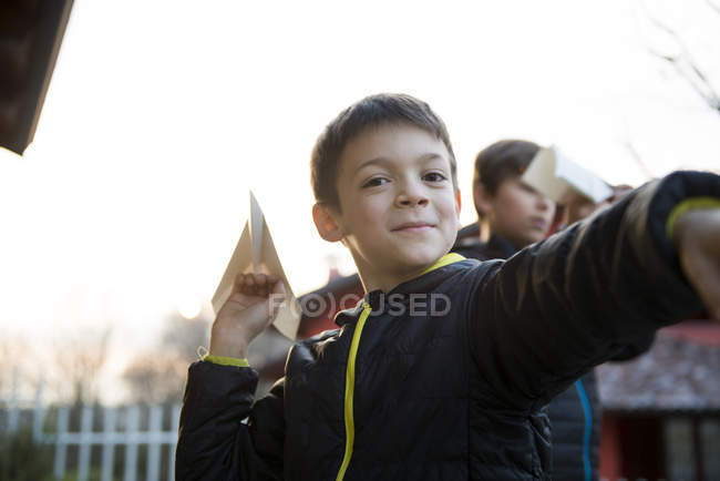 Boy with paper plane — Stock Photo