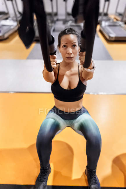 Woman doing suspension traning — Stock Photo