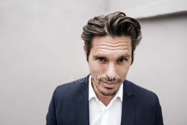 Businessman looking at camera — Stock Photo