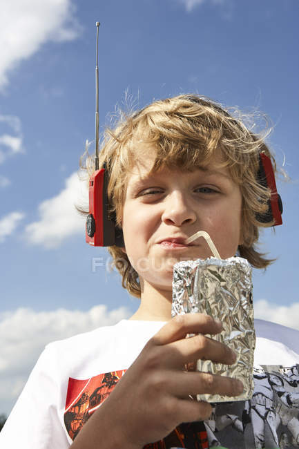 Portrait of boy with beverage — Stock Photo