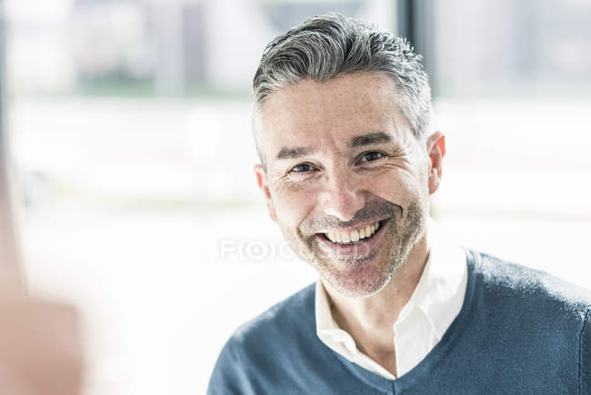 Businessman with stubble looking at camera — Stock Photo