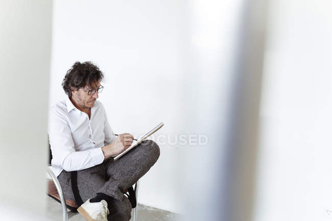 Architect sketching in notebook — Stock Photo