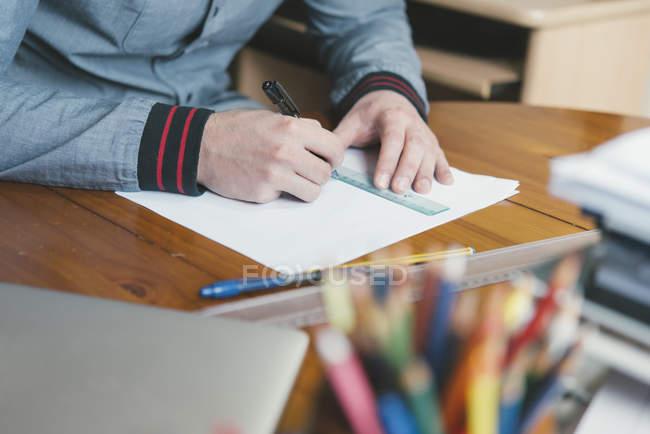 Close-up of man drafting at desk — Stock Photo