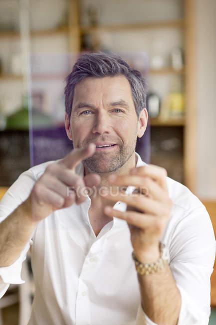 Businessman using portable device — Stock Photo