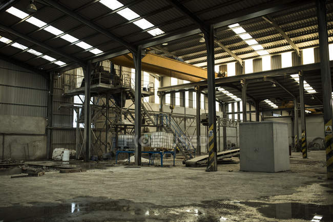 empty concrete factory warehouse stock photo 165717560