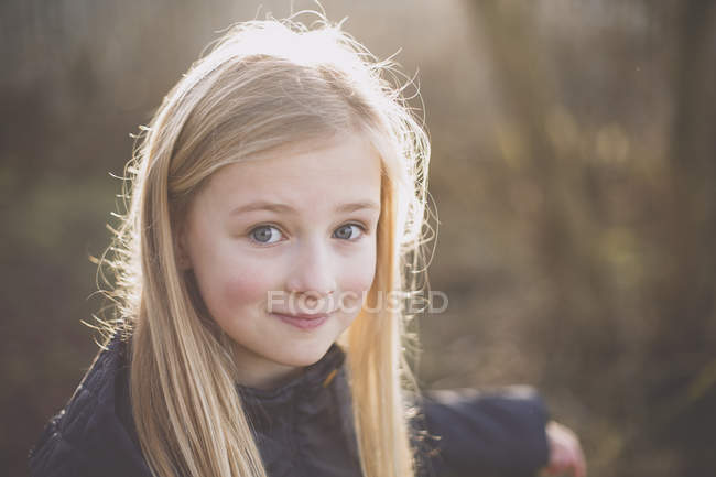 Smiling girl outdoors — Stock Photo