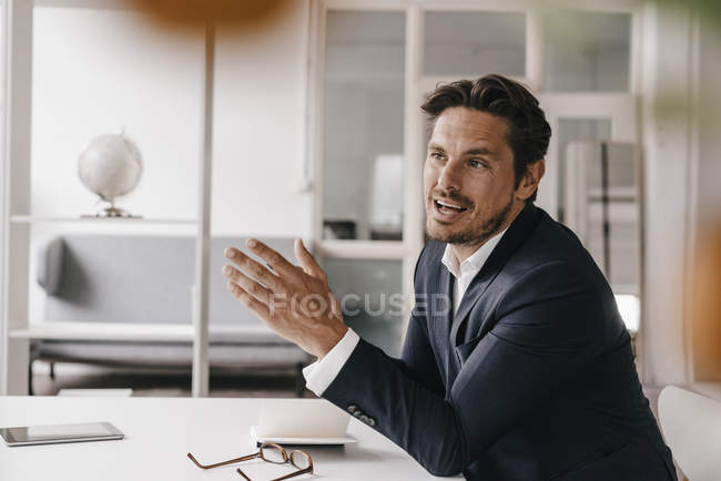 Businessman talking in office — Stock Photo