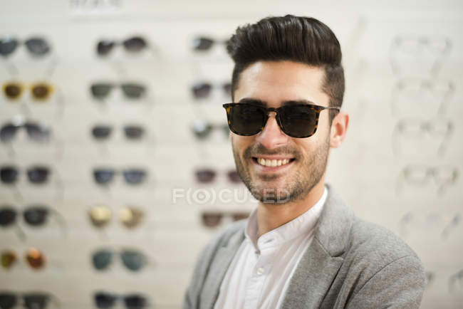 Man wearing glasses at the optician shop — Stock Photo