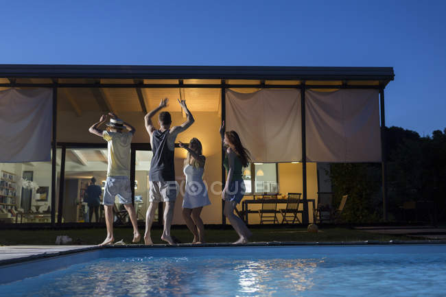 Friends dancing at poolside — Stock Photo
