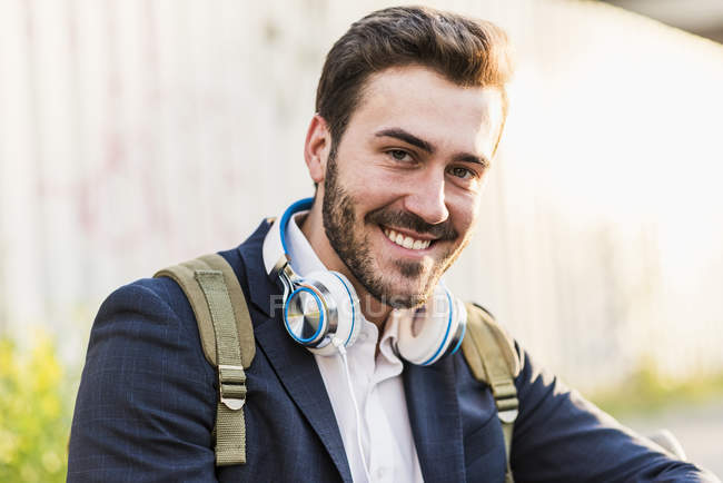 Man with headphones looking at camera — Stock Photo