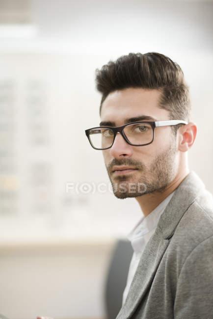 641c3c127922 Man wearing glasses — looking at camera