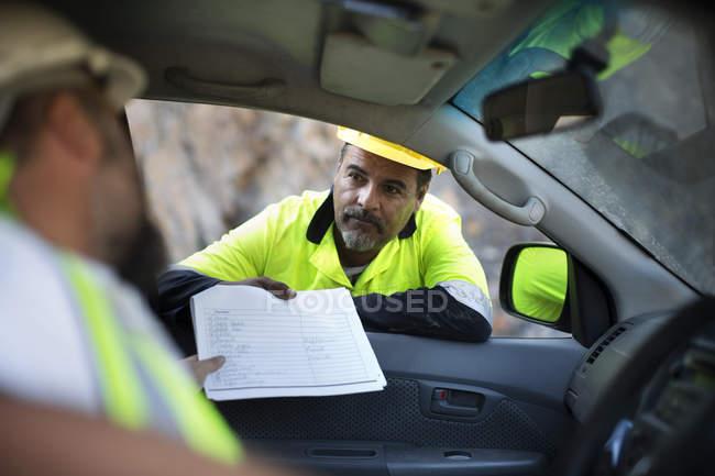 Worker handing over documents — Stock Photo