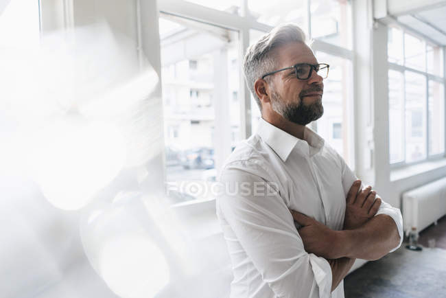 Businessman standing in office — Stock Photo