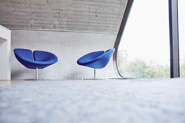 Two chairs in empty attic office — Stock Photo