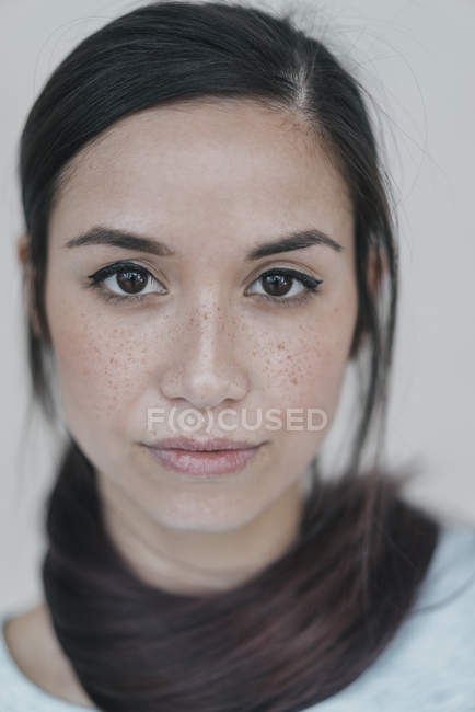 Woman with ponytail wrapped around neck — Stock Photo