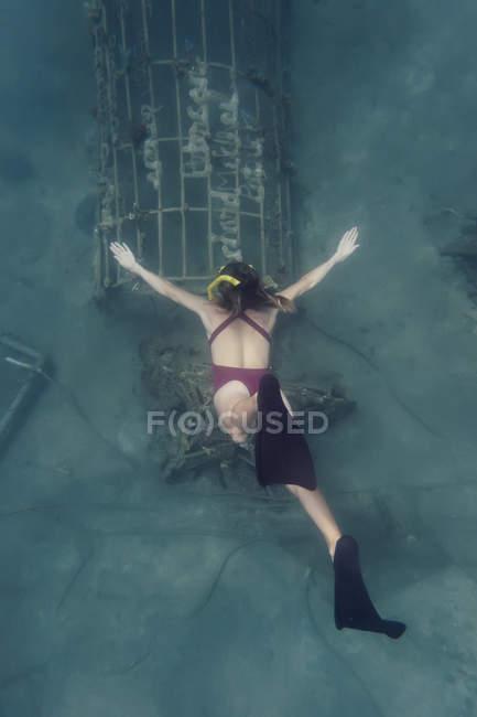Caucasian Woman swimming  underwater — Stock Photo