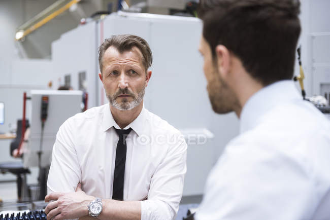 Businessman looking at colleague — Stock Photo