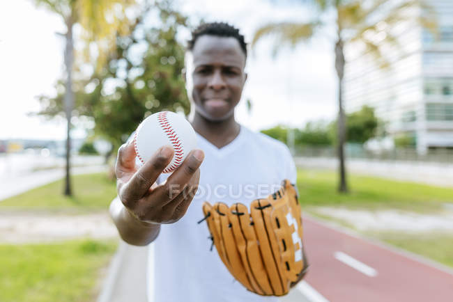 Man holding baseball — Stock Photo