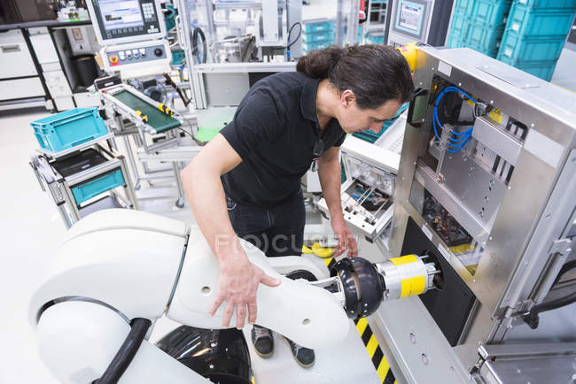 Man working in factory — Stock Photo