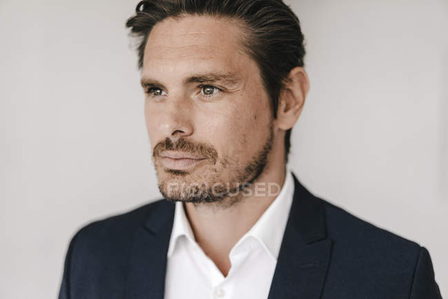 Serious businessman looking aside — Stock Photo
