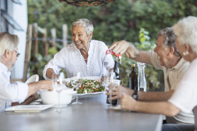 Woman serving lunch — Stock Photo