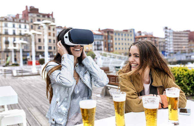 Young women using VR glasses — Stock Photo