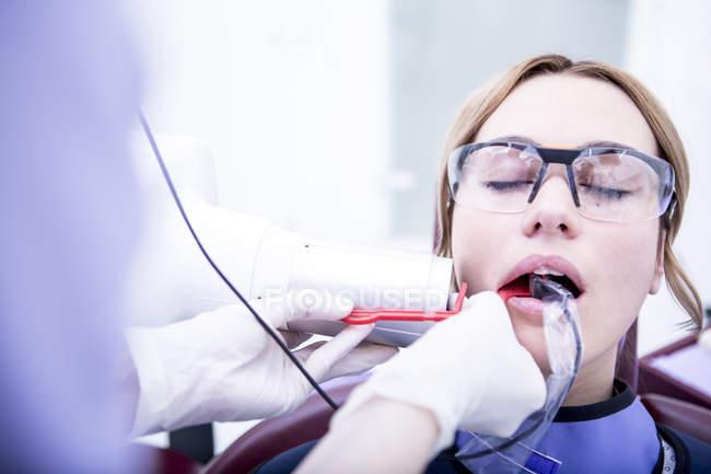 Woman receiving dental treatment — Stock Photo