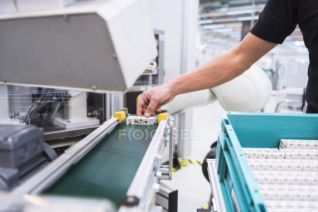Hand holding product of assembly robot — Stock Photo