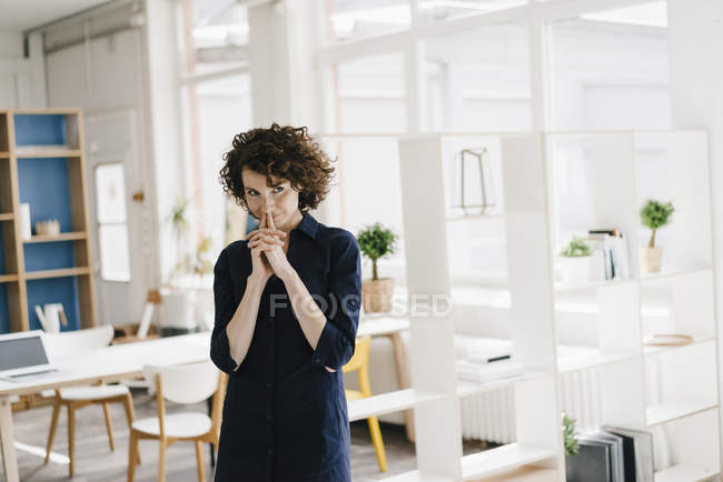 Businesswoman thinking and smiling — Stock Photo