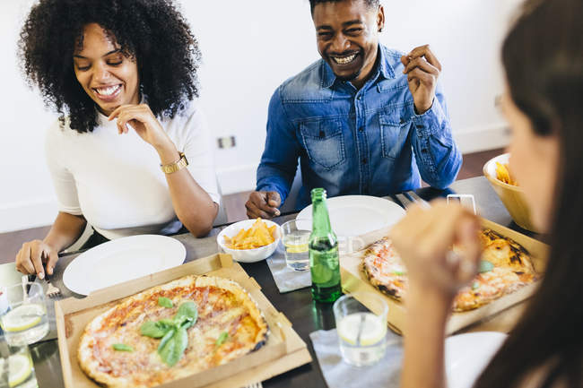 Friends having a pizza — Stock Photo