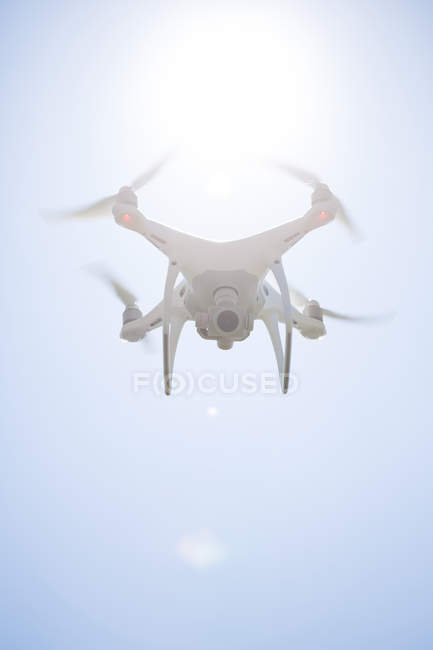 Close up of Flying drone with camera at backlight — Stock Photo
