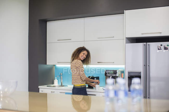 Woman in office kitchen — Stock Photo