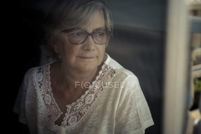 Senior woman looking aside — Stock Photo