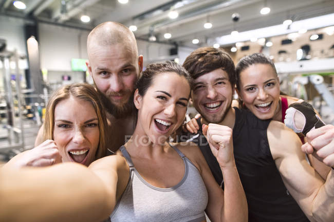 Athletes taking selfies in gym — Stock Photo