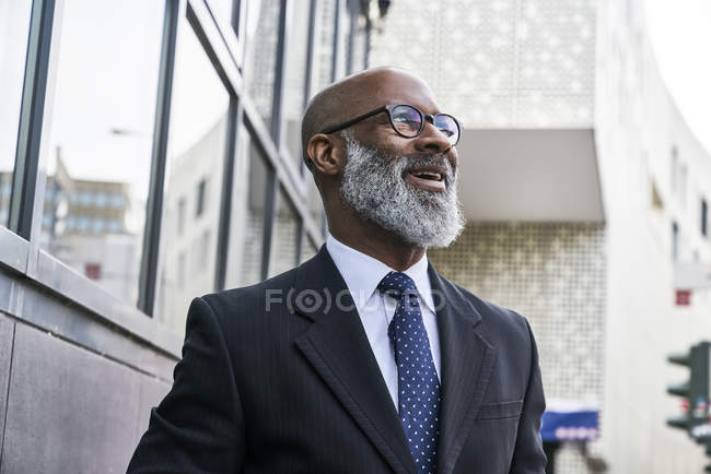 Businessman in spectacles looking aside — Stock Photo